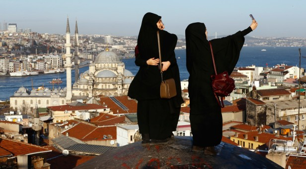 Turkey  Women take selfie photographs with Hagia Sophia in the background in Istanbul