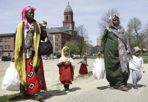 "Somali women and their children walk through downtown Lewiston, Maine, Tuesday, in a May 8, 2007, photo. Over the past six years, as many as 3,500 black refugees from the wartorn African country have settled in this nearly all-white, heavily French-Canadian and largely Roman Catholic city of 36,000, giving Lewiston the highest concentration of Somalis anywhere in America.""Their children are the only assets they have. They left everything else in Somalia,"" said Said Mohamud, manager of the Mogadishu Store. (AP Photo/Robert F. Bukaty)"